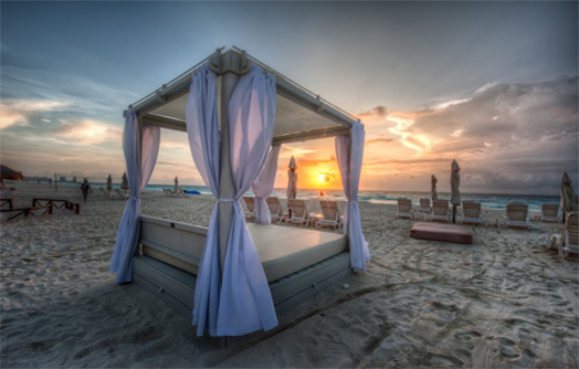 White Fabric Beach Bed with four poster roof Facing The Sea
