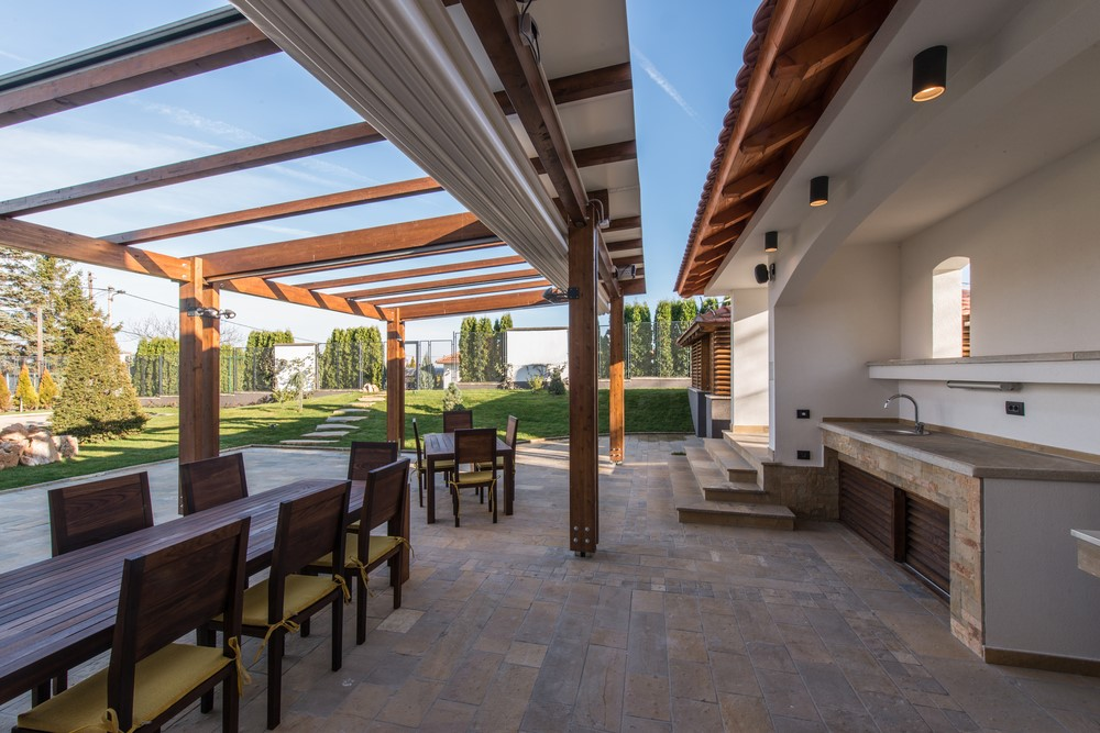A retractable pergola in a family backyard.