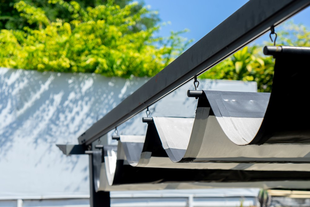 A metal retractable pergola for business use.